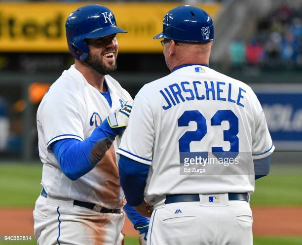 Mike Moustakas of the Kansas City Royals celebrates his triple with Mike Jirschele of the Kansas City Royals in the third inning against the Chicago...