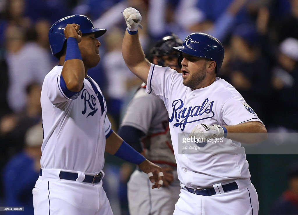 Mike Moustakas #8 of the Kansas City Royals celebrates his two-run home run with Salvador Perez in the eighth inning against the Cleveland Indians at Kauffman Stadium on June 10, 2014 in Kansas City, Missouri.