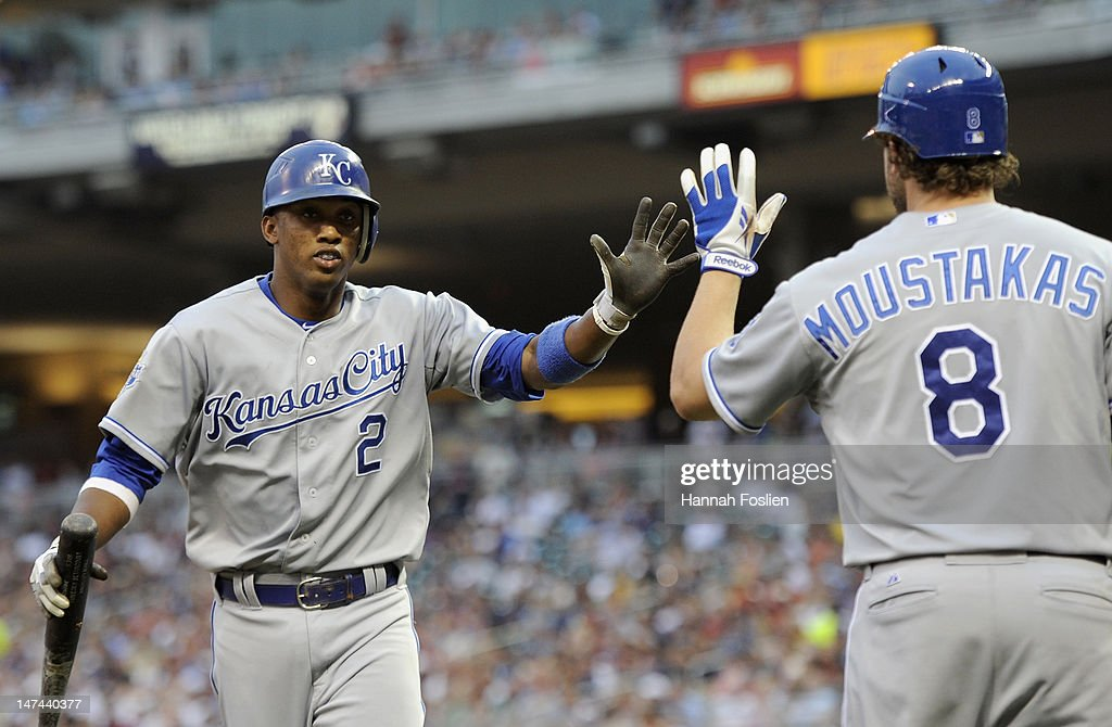 Mike Moustakas #8 of the Kansas City Royals congratulates Alcides Escobar #2 on scoring against the Minnesota Twins during the fifth inning on June 29, 2012 at Target Field in Minneapolis, Minnesota.
