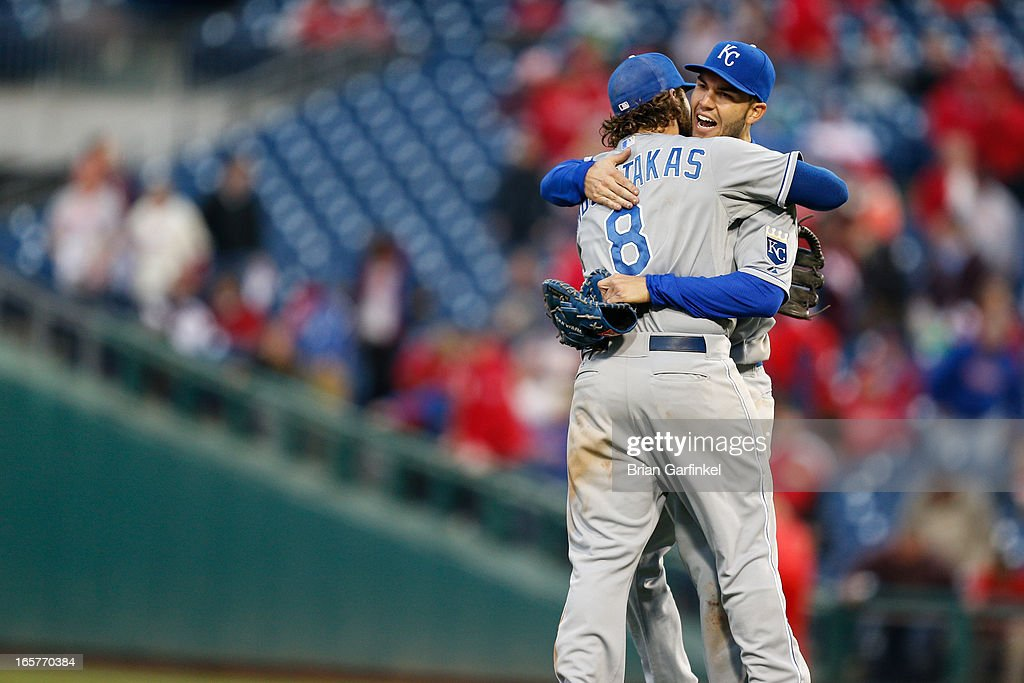 Mike Moustakas #8 of the Kansas City Royals embraces Eric Hosmer #35 after the Opening Day game against the Philadelphia Phillies at Citizens Bank Park on April 5, 2013 in Philadelphia, Pennsylvania. The Royals won 13 to 4.