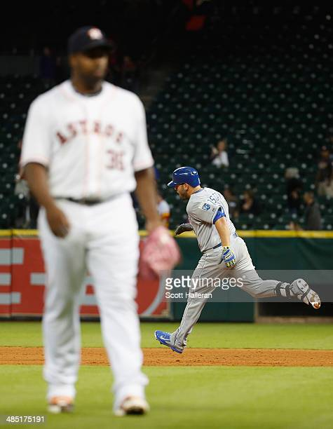 Mike Moustakas of the Kansas City Royals hits a solo home run to take the lead in the 11th inning against Jerome Williams of the Houston Astros at...