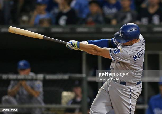 Mike Moustakas of the Kansas City Royals hits a tworun home run his second home run of the game in the 8th inning against the Chicago White Sox at US...