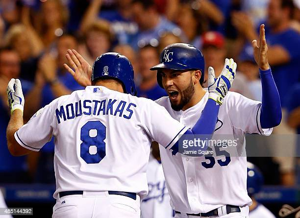 Mike Moustakas of the Kansas City Royals is congratulated by Eric Hosmer after hitting a home run during the 6th inning of the game against the...