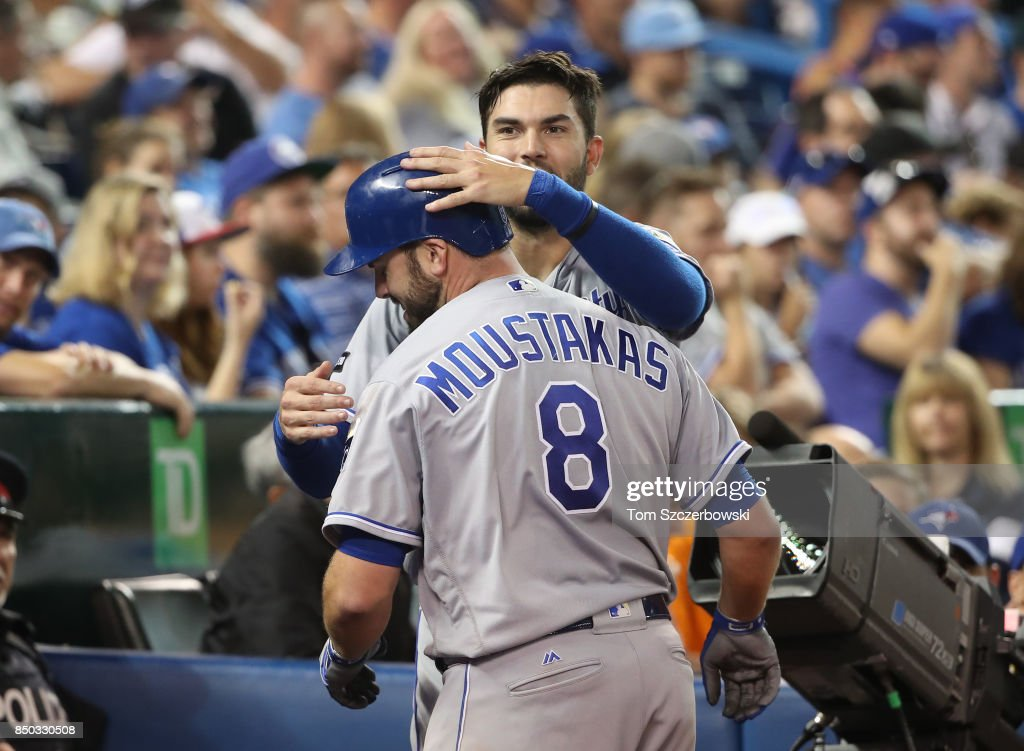 Mike Moustakas #8 of the Kansas City Royals is congratulated by Eric Hosmer #35 after hitting a solo home run in the sixth inning, setting a club record with 37 home runs in a season, during MLB game action against the Toronto Blue Jays at Rogers Centre on September 20, 2017 in Toronto, Canada.