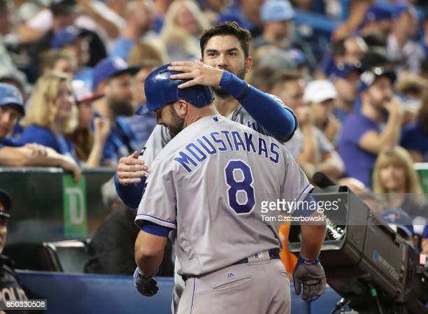 Mike Moustakas of the Kansas City Royals is congratulated by Eric Hosmer after hitting a solo home run in the sixth inning setting a club record with...