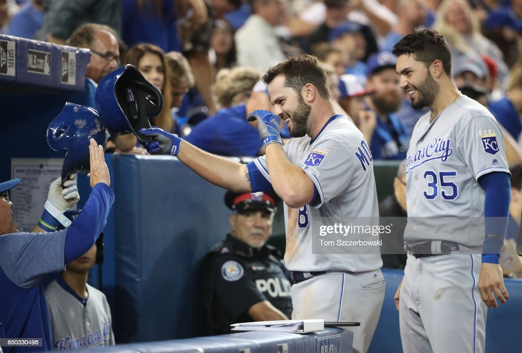 Mike Moustakas #8 of the Kansas City Royals is congratulated by manager Ned Yost #3 and Eric Hosmer #35 after hitting a solo home run in the sixth inning, setting a club record with 37 home runs in a season, during MLB game action against the Toronto Blue Jays at Rogers Centre on September 20, 2017 in Toronto, Canada.