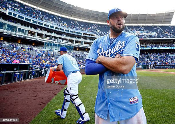 Mike Moustakas of the Kansas City Royals is doused with water by catcher Drew Butera after the Royals defeated the Baltimore Orioles 53 to win the...