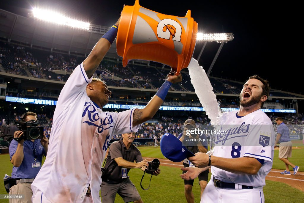 Mike Moustakas #8 of the Kansas City Royals is doused with water by catcher Salvador Perez #13 after the Royals defeated the Detroit Tigers 16-4 to win the game at Kauffman Stadium on July 20, 2017 in Kansas City, Missouri.