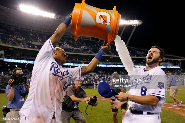 Mike Moustakas of the Kansas City Royals is doused with water by catcher Salvador Perez after the Royals defeated the Detroit Tigers 164 to win the...