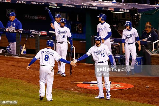 Mike Moustakas of the Kansas City Royals is greeted by Paulo Orlando of the Kansas City Royals after scoring a run on an RBI double hit by Alex...