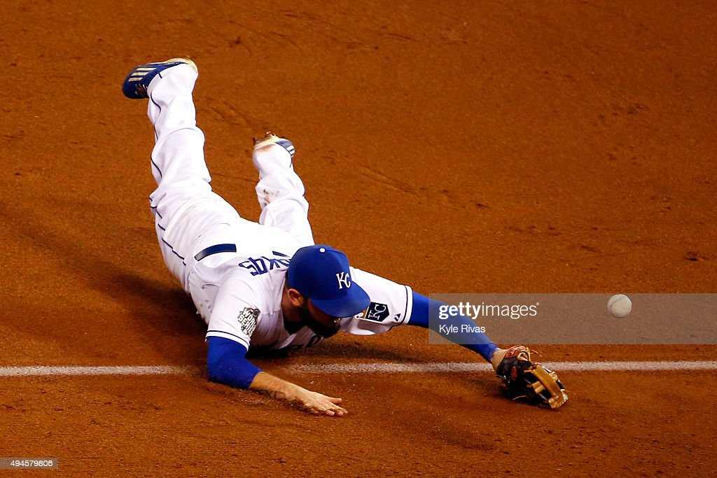 Mike Moustakas #8 of the Kansas City Royals misses a catch against the New York Mets during Game One of the 2015 World Series at Kauffman Stadium on October 27, 2015 in Kansas City, Missouri.