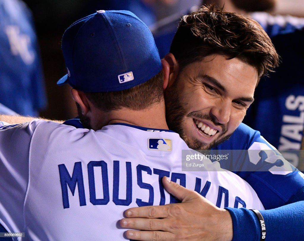 Mike Moustakas #8 of the Kansas City Royals receives a hug from Eric Hosmer #35 after he was taken out of a game against the Arizona Diamondbacks in the sixth inning at Kauffman Stadium on September 30, 2017 in Kansas City, Missouri.