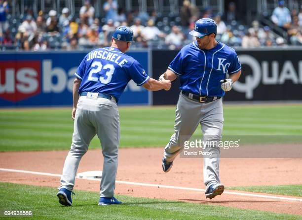 Mike Moustakas of the Kansas City Royals right is congratulated by Mike Jirschele after hitting a threerun home run during the first inning of a...