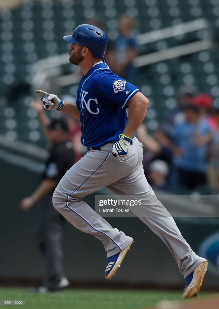 Mike Moustakas #8 of the Kansas City Royals rounds the bases after hitting a solo home run against the Minnesota Twins during the ninth inning of the game on July 11, 2018 at Target Field in Minneapolis, Minnesota. The Twins defeated the Royals 8-5.