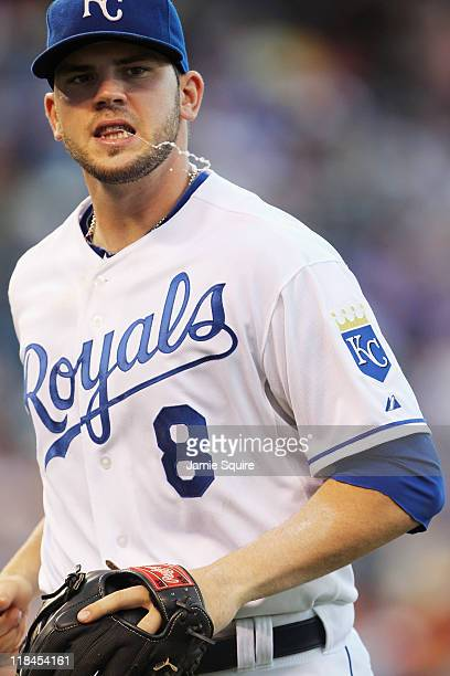 Mike Moustakas of the Kansas City Royals spits during the game against the Detroit Tigers on July 7 2011 at Kauffman Stadium in Kansas City Missouri