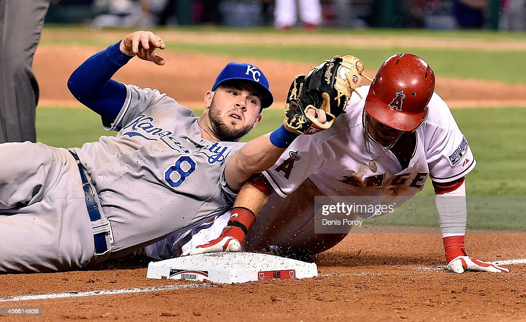 Mike Moustakas #8 of the Kansas City Royals tags out Collin Cowgill #7 of the Los Angeles Angels at third base in the eighth inning during Game Two of the American League Division Series at Angel Stadium of Anaheim on October 3, 2014 in Anaheim, California.