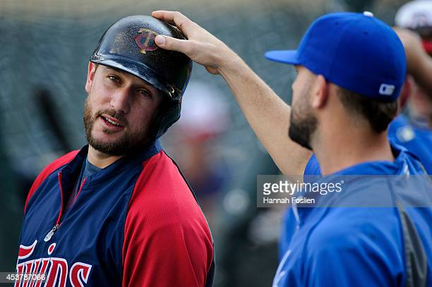 Mike Moustakas of the Kansas City Royals touches the pine tar on the helmet of Trevor Plouffe of the Minnesota Twins during batting practice on...
