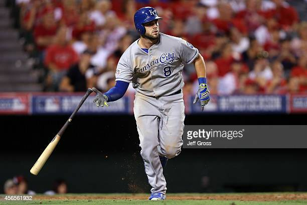 Mike Moustakas of the Kansas City Royals watches his solo home run in the eleventh inning to take a 32 lead against the Los Angeles Angels during...
