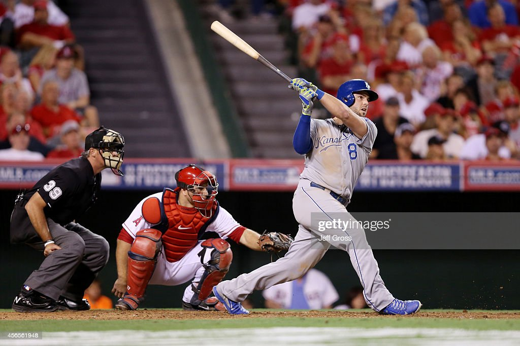 Mike Moustakas #8 of the Kansas City Royals watches his solo home run in the eleventh inning to take a 3-2 lead against the Los Angeles Angels during Game One of the American League Division Series at Angel Stadium of Anaheim on October 2, 2014 in Anaheim, California.