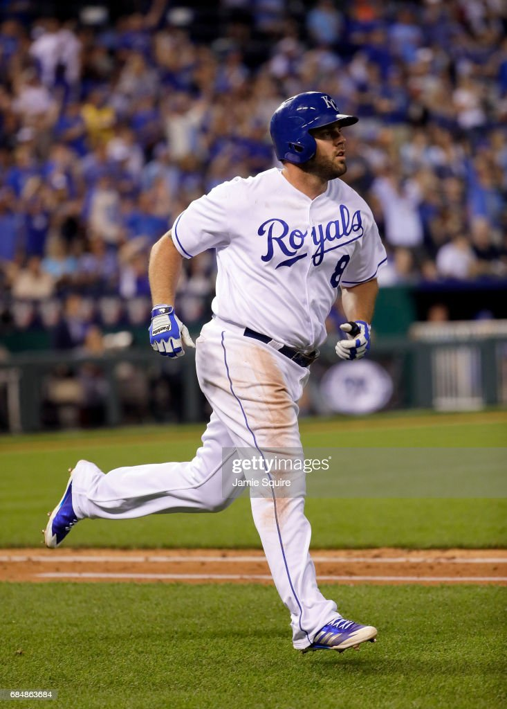 Mike Moustakas #8 of the Kansas City Royals watches the ball fly over the wall for a home run during the 5th inning of the game against the New York Yankees at Kauffman Stadium on May 18, 2017 in Kansas City, Missouri.