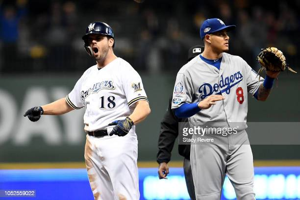 Mike Moustakas of the Milwaukee Brewers celebrates after hits an RBI double against HyunJin Ryu of the Los Angeles Dodgers during the first inning n...