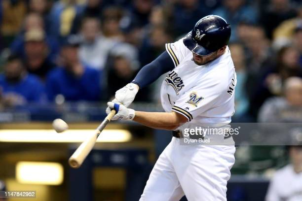 Mike Moustakas of the Milwaukee Brewers hits a home run in the second inning against the Washington Nationals at Miller Park on May 08 2019 in...