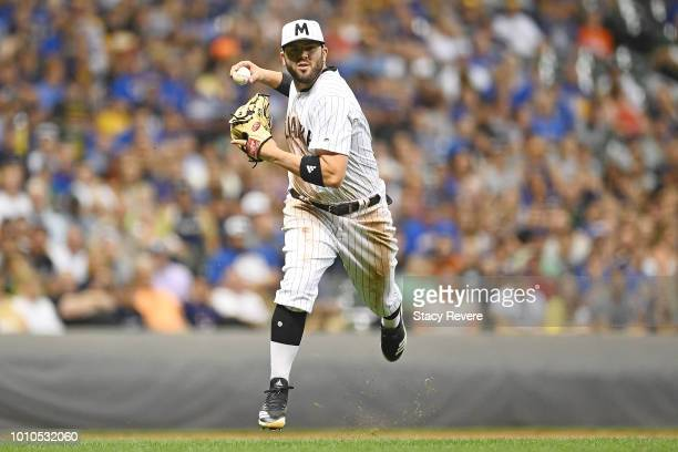 Mike Moustakas of the Milwaukee Brewers makes a throw to first base during the ninth inning of a game against the Colorado Rockies at Miller Park on...