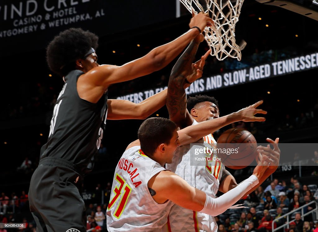 Mike Muscala #31 and John Collins #20 of the Atlanta Hawks battle for a rebound against Jarrett Allen #31 of the Brooklyn Nets at Philips Arena on January 12, 2018 in Atlanta, Georgia.