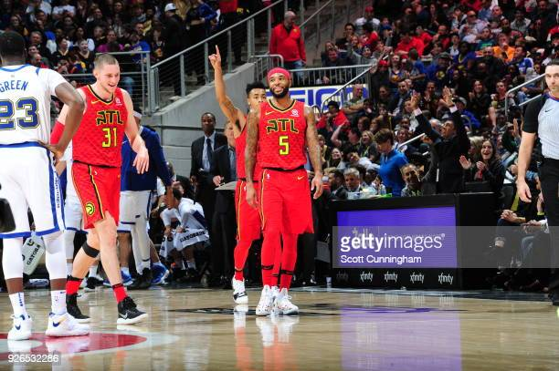 Mike Muscala of the Atlanta Hawks and Malcolm Delaney of the Atlanta Hawks react on the court against the Golden State Warriors on March 2 2018 at...