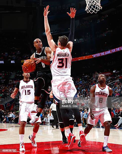 Mike Muscala of the Atlanta Hawks defends against Jarrett Jack of the Brooklyn Nets at Philips Arena on April 4 2015 in Atlanta Georgia NOTE TO USER...