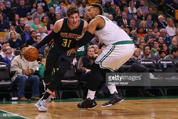 Mike Muscala of the Atlanta Hawks drives against Jared Sullinger of the Boston Celtics at TD Garden on November 13 2015 in Boston Massachusetts The...