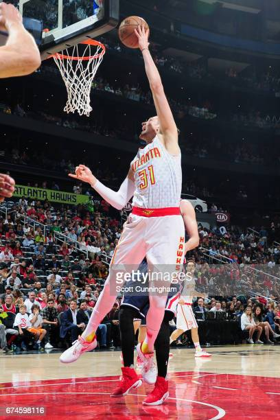 Mike Muscala of the Atlanta Hawks goes to the basket against the Washington Wizards during Game Six of the Eastern Conference Quarterfinals of the...