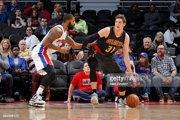 Mike Muscala of the Atlanta Hawks handles the ball against the Detroit Pistons during the game on October 23 2015 at The Palace of Auburn Hills in...