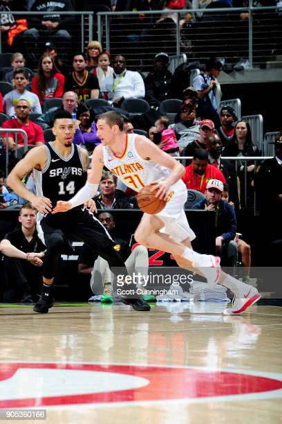 Mike Muscala of the Atlanta Hawks handles the ball during the game against the San Antonio Spurs on January 15 2018 at Philips Arena in Atlanta...