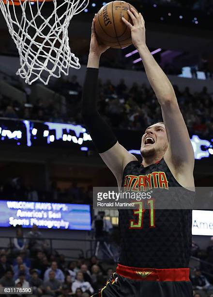 Mike Muscala of the Atlanta Hawks makes a slam dunk against the Dallas Mavericks at American Airlines Center on January 7 2017 in Dallas Texas NOTE...