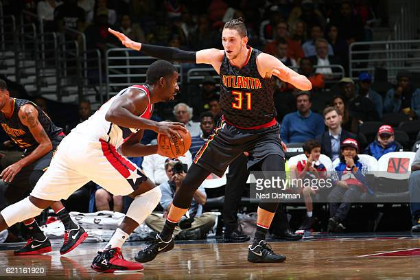 Mike Muscala of the Atlanta Hawks plays defense against Andrew Nicholson of the Washington Wizards during a game on November 4 2016 at the Verizon...