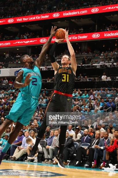 Mike Muscala of the Atlanta Hawks shoots the ball against Marvin Williams of the Charlotte Hornets during the game on October 20 2017 at Spectrum...