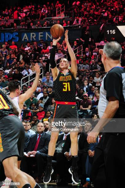 Mike Muscala of the Atlanta Hawks shoots the ball against the Philadelphia 76ers on April 10 2018 at Philips Arena in Atlanta Georgia NOTE TO USER...