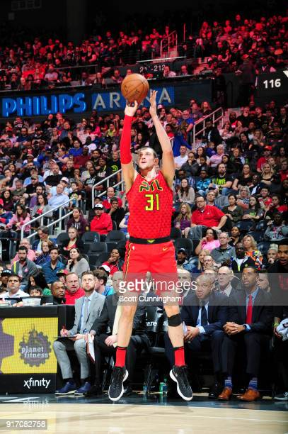 Mike Muscala of the Atlanta Hawks shoots the ball against the Detroit Pistons on February 11 2018 at Philips Arena in Atlanta Georgia NOTE TO USER...