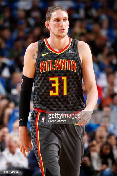 Mike Muscala of the Atlanta Hawks walks up court against the Dallas Mavericks at the American Airlines Center in Dallas Texas on October 18 2017 NOTE...