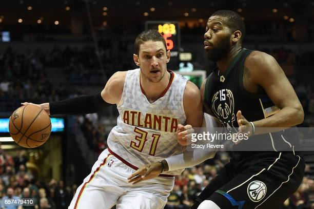 Mike Muscala of the Atlanta Hawks works against Greg Monroe of the Milwaukee Bucks during the first half of a game at the BMO Harris Bradley Center...
