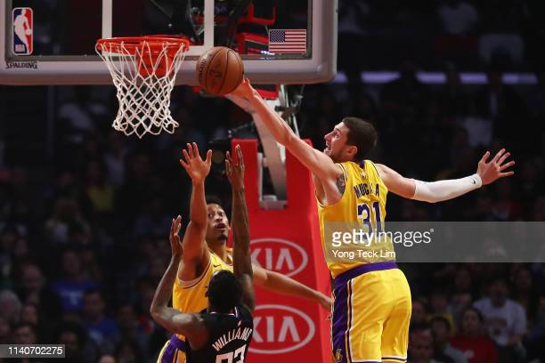 Mike Muscala of the Los Angeles Lakers blocks a shot attempt by Lou Williams of the Los Angeles Clippers during the first half at Staples Center on...