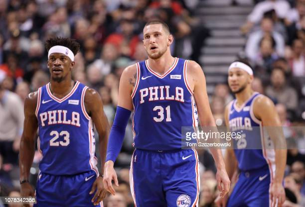 Mike Muscala of the Philadelphia 76ers and Jimmy Butler and Ben Simmons during their NBA game against the Toronto Raptors at Scotiabank Arena on...