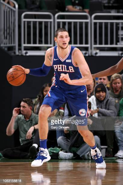 Mike Muscala of the Philadelphia 76ers handles the ball against the Milwaukee Bucks on October 24 2018 at Fiserv Forum in Milwaukee Wisconsin NOTE TO...