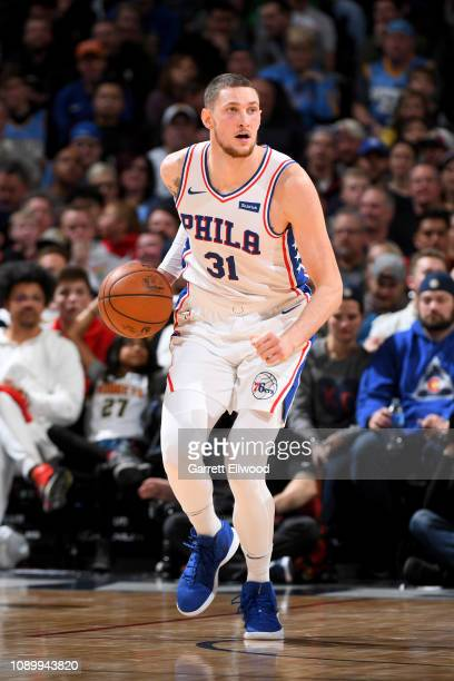 Mike Muscala of the Philadelphia 76ers handles the ball during the game against the Denver Nuggets on January 26 2019 at the Pepsi Center in Denver...