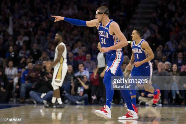 Mike Muscala of the Philadelphia 76ers points against the New Orleans Pelicans at the Wells Fargo Center on November 21 2018 in Philadelphia...