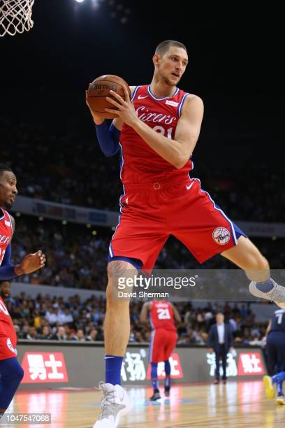Mike Muscala of the Philadelphia 76ers rebounds during the game as part of the 2018 China Games on October 8 2018 at the Shenzhen Universiade Center...