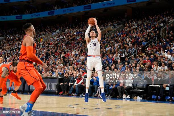 Mike Muscala of the Philadelphia 76ers shoots a three point basket against the Oklahoma City Thunder on January 19 2019 at the Wells Fargo Center in...