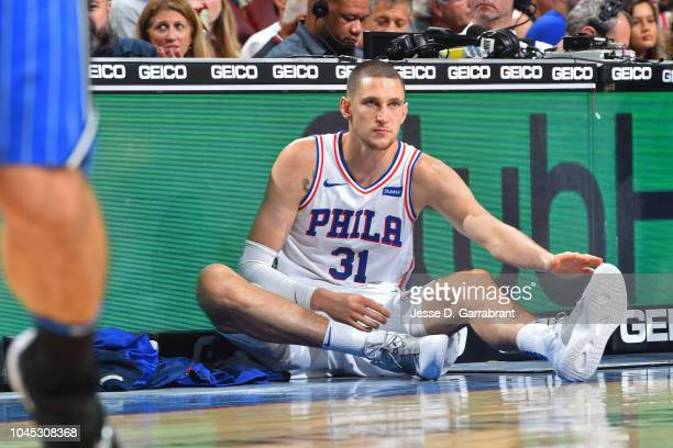 Mike Muscala of the Philadelphia 76ers stretches again the Orlando Magic during a preseason game on October 1 2018 at the Wells Fargo Center in...