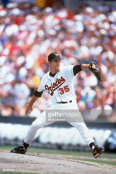 Mike Mussina of the Baltimore Orioles pitches during a Major League Baseball game circa 19912000 at Camden Yards in Baltimore Maryland